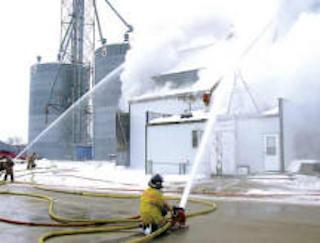 firefighters putting out a burning building
