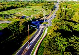 birds-eye view of tress, road, and rotary
