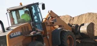 man driving a loader at a construction site